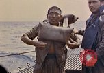 Image of US submarine rescues Japanese survivors at sea Pacific Ocean, 1945, second 28 stock footage video 65675052639