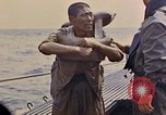 Image of US submarine rescues Japanese survivors at sea Pacific Ocean, 1945, second 31 stock footage video 65675052639