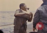 Image of US submarine rescues Japanese survivors at sea Pacific Ocean, 1945, second 32 stock footage video 65675052639