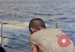 Image of US submarine rescues Japanese survivors at sea Pacific Ocean, 1945, second 40 stock footage video 65675052639