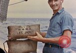 Image of US submarine rescues Japanese survivors at sea Pacific Ocean, 1945, second 51 stock footage video 65675052639