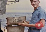 Image of US submarine rescues Japanese survivors at sea Pacific Ocean, 1945, second 52 stock footage video 65675052639