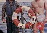 Image of US submarine rescues Japanese survivors at sea Pacific Ocean, 1945, second 58 stock footage video 65675052639
