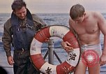 Image of US submarine rescues Japanese survivors at sea Pacific Ocean, 1945, second 60 stock footage video 65675052639
