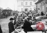Image of US soldiers visit an open air market Archangel Russia, 1918, second 6 stock footage video 65675053036