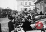 Image of US soldiers visit an open air market Archangel Russia, 1918, second 7 stock footage video 65675053036