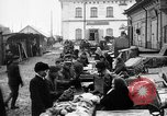 Image of US soldiers visit an open air market Archangel Russia, 1918, second 16 stock footage video 65675053036