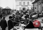 Image of US soldiers visit an open air market Archangel Russia, 1918, second 17 stock footage video 65675053036
