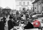 Image of US soldiers visit an open air market Archangel Russia, 1918, second 21 stock footage video 65675053036