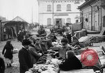 Image of US soldiers visit an open air market Archangel Russia, 1918, second 22 stock footage video 65675053036