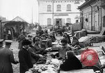 Image of US soldiers visit an open air market Archangel Russia, 1918, second 24 stock footage video 65675053036