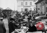 Image of US soldiers visit an open air market Archangel Russia, 1918, second 25 stock footage video 65675053036