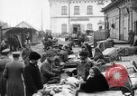 Image of US soldiers visit an open air market Archangel Russia, 1918, second 26 stock footage video 65675053036