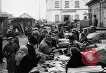 Image of US soldiers visit an open air market Archangel Russia, 1918, second 32 stock footage video 65675053036