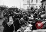 Image of US soldiers visit an open air market Archangel Russia, 1918, second 33 stock footage video 65675053036