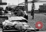 Image of US soldiers visit an open air market Archangel Russia, 1918, second 40 stock footage video 65675053036