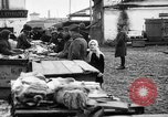Image of US soldiers visit an open air market Archangel Russia, 1918, second 41 stock footage video 65675053036