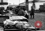 Image of US soldiers visit an open air market Archangel Russia, 1918, second 44 stock footage video 65675053036