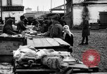 Image of US soldiers visit an open air market Archangel Russia, 1918, second 46 stock footage video 65675053036
