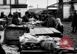 Image of US soldiers visit an open air market Archangel Russia, 1918, second 50 stock footage video 65675053036