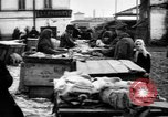 Image of US soldiers visit an open air market Archangel Russia, 1918, second 51 stock footage video 65675053036