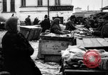 Image of US soldiers visit an open air market Archangel Russia, 1918, second 54 stock footage video 65675053036