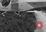 Image of Bell 30 helicopter spraying pesticides United States USA, 1942, second 30 stock footage video 65675053061