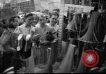 Image of women buying silk stockings during war ration United States USA, 1942, second 4 stock footage video 65675053064