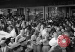 Image of women buying silk stockings during war ration United States USA, 1942, second 14 stock footage video 65675053064