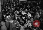 Image of women buying silk stockings during war ration United States USA, 1942, second 15 stock footage video 65675053064