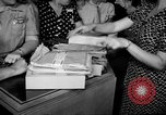 Image of women buying silk stockings during war ration United States USA, 1942, second 20 stock footage video 65675053064