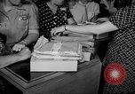 Image of women buying silk stockings during war ration United States USA, 1942, second 21 stock footage video 65675053064