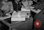 Image of women buying silk stockings during war ration United States USA, 1942, second 22 stock footage video 65675053064