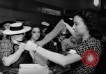 Image of women buying silk stockings during war ration United States USA, 1942, second 28 stock footage video 65675053064