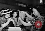 Image of women buying silk stockings during war ration United States USA, 1942, second 30 stock footage video 65675053064