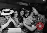 Image of women buying silk stockings during war ration United States USA, 1942, second 32 stock footage video 65675053064