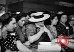 Image of women buying silk stockings during war ration United States USA, 1942, second 33 stock footage video 65675053064