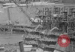 Image of uncompleted structure Bonneville Oregon USA, 1936, second 45 stock footage video 65675053237