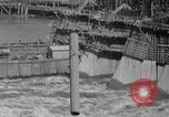 Image of uncompleted structure Bonneville Oregon USA, 1936, second 46 stock footage video 65675053237