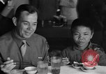 Image of American soldiers dine with Chinese children China, 1943, second 10 stock footage video 65675053427
