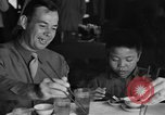 Image of American soldiers dine with Chinese children China, 1943, second 11 stock footage video 65675053427