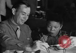 Image of American soldiers dine with Chinese children China, 1943, second 13 stock footage video 65675053427