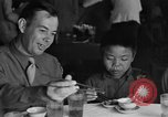 Image of American soldiers dine with Chinese children China, 1943, second 16 stock footage video 65675053427