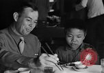 Image of American soldiers dine with Chinese children China, 1943, second 17 stock footage video 65675053427