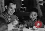 Image of American soldiers dine with Chinese children China, 1943, second 19 stock footage video 65675053427
