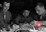 Image of American soldiers dine with Chinese children China, 1943, second 21 stock footage video 65675053427