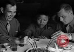 Image of American soldiers dine with Chinese children China, 1943, second 22 stock footage video 65675053427