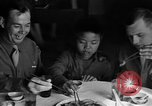 Image of American soldiers dine with Chinese children China, 1943, second 23 stock footage video 65675053427
