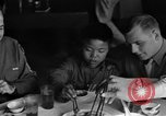Image of American soldiers dine with Chinese children China, 1943, second 28 stock footage video 65675053427