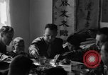 Image of American soldiers dine with Chinese children China, 1943, second 49 stock footage video 65675053427
